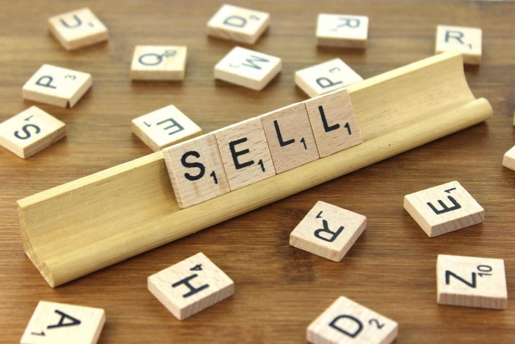 the word sell spelt out in scrabble letters