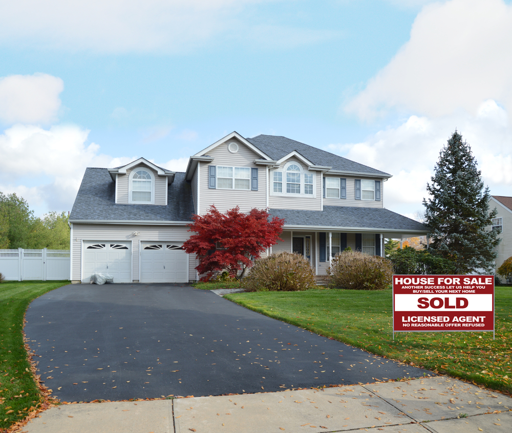 Picture of a property with a sold sign outside