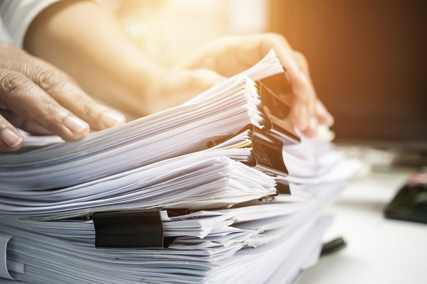 a pile of documents needed when selling your house